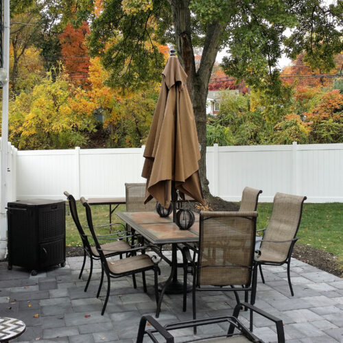 white privacy fence in yard with picnic table