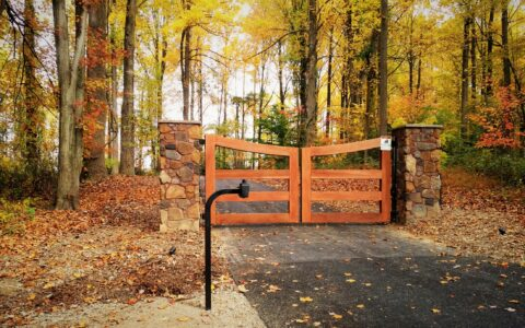 wood rail driveway gate with automated opener