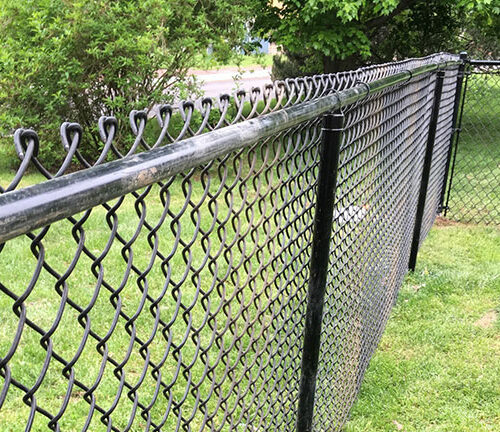 Chain link fence with black vinyl piping