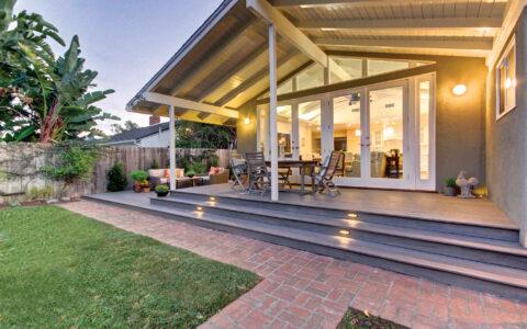 Well-lit covered backyard deck