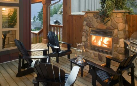 Outdoor seating area with fireplace and grill