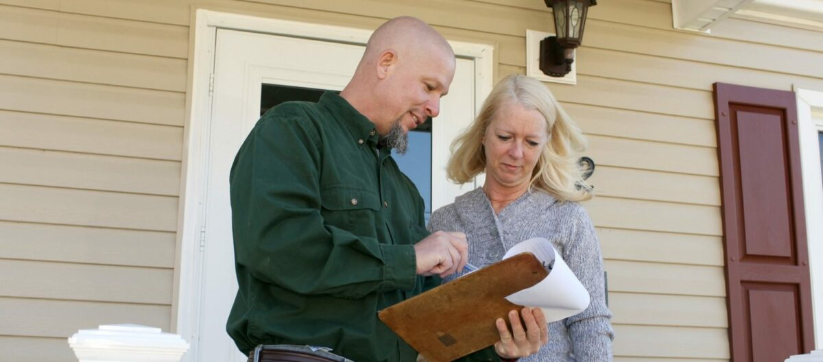Contractor going over details of home inspection.