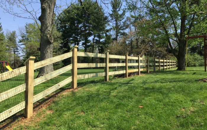 post and board fence with wire mesh