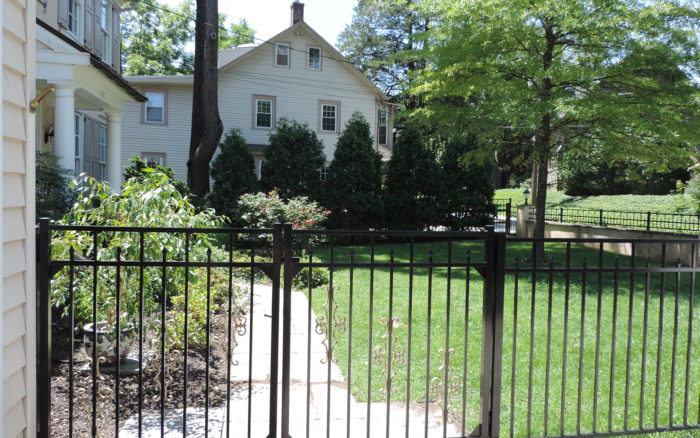 Ornamental aluminum fence with double gate in yard