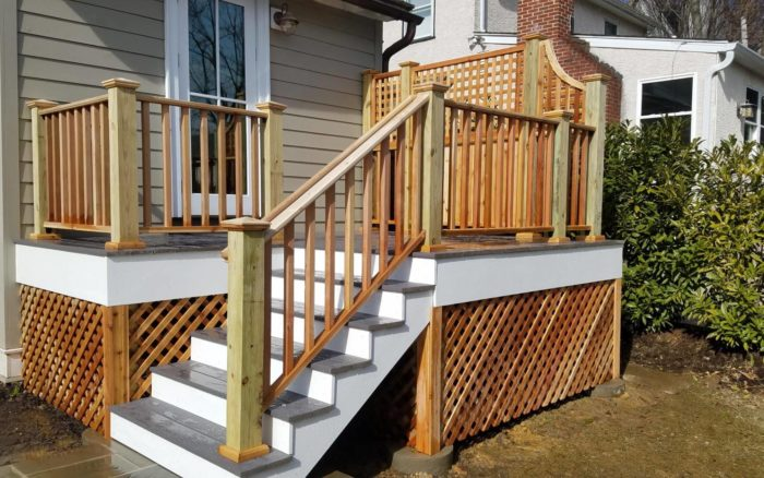 custom deck with wood railing