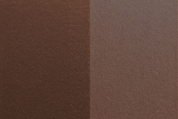 A swatch of Woodlands Brown fencing, showing new and weathered colors side by side